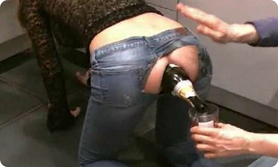 chick pours champagne out of her asshole